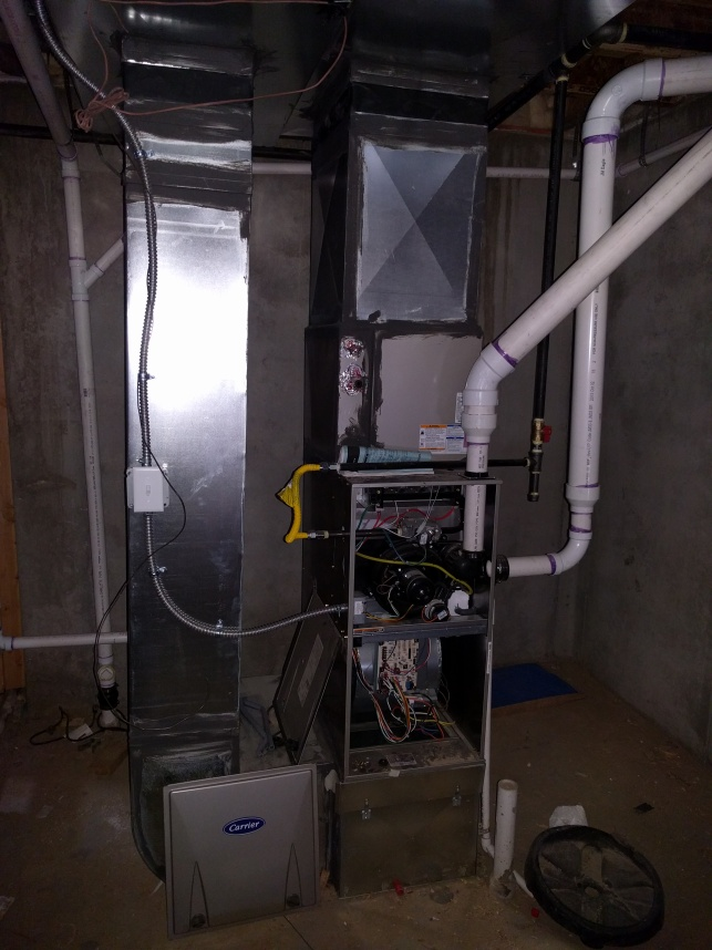 The furnace in the mechanical room in the basement